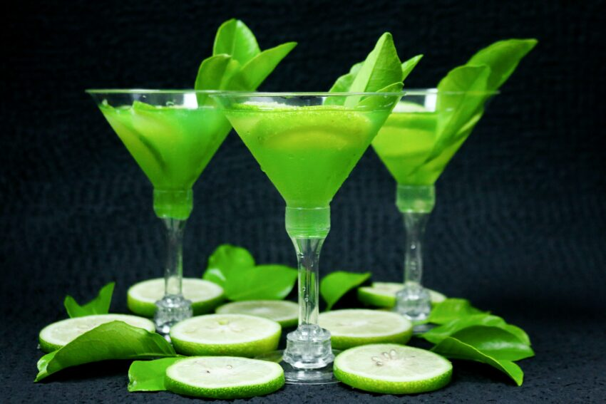 sliced lime on clear cocktail glass