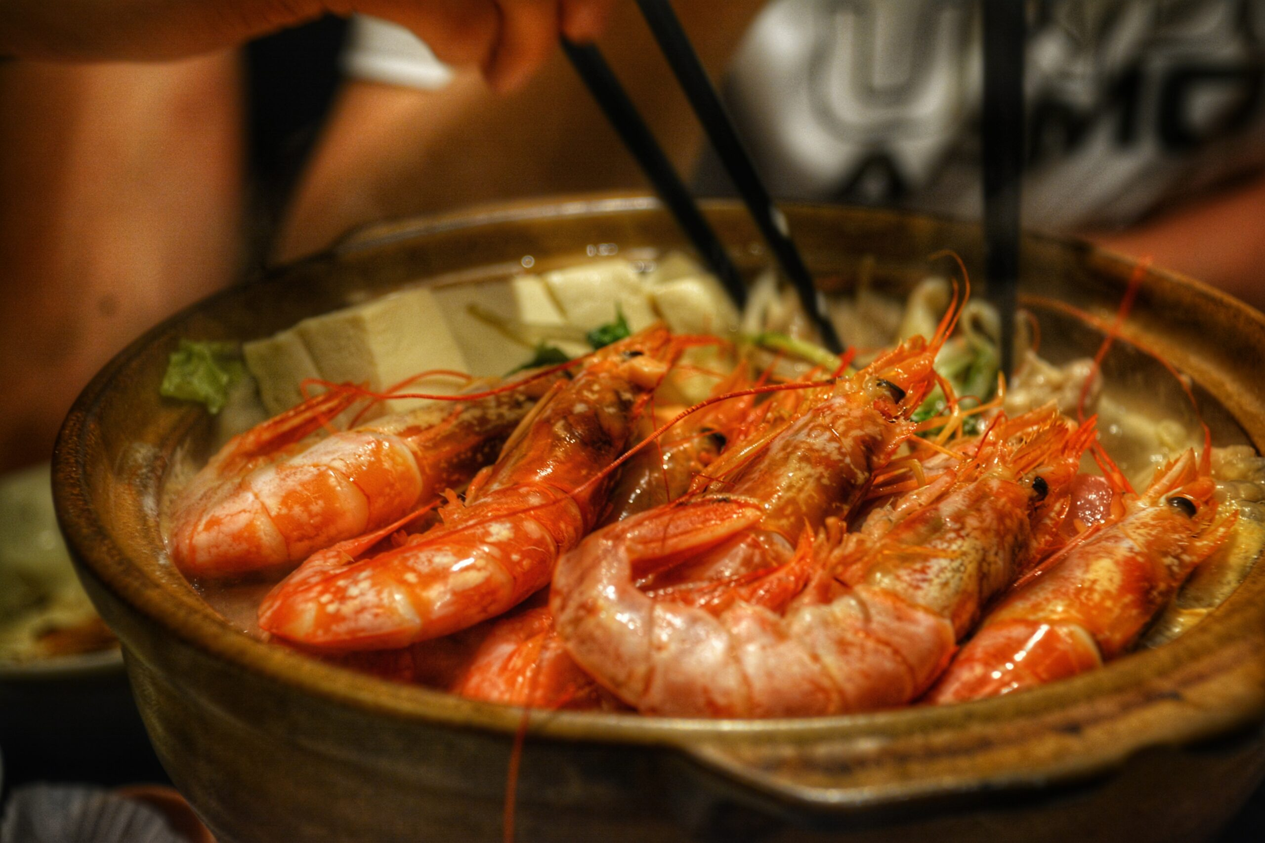 cooked shrimps on brown ceramic bowl