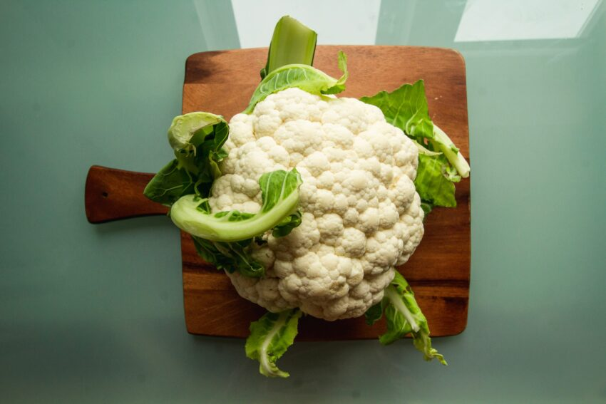 white cauliflower on brown wooden chopping board