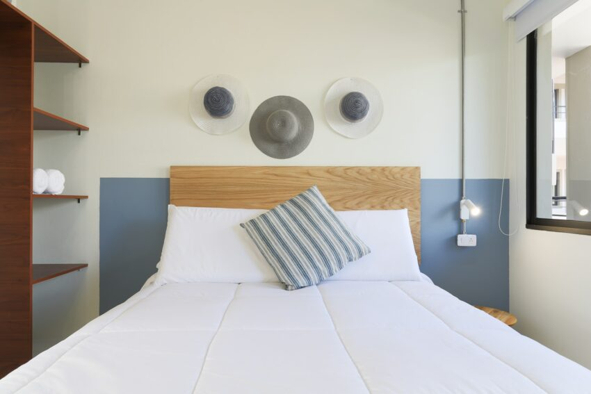 white bed with throw pillows