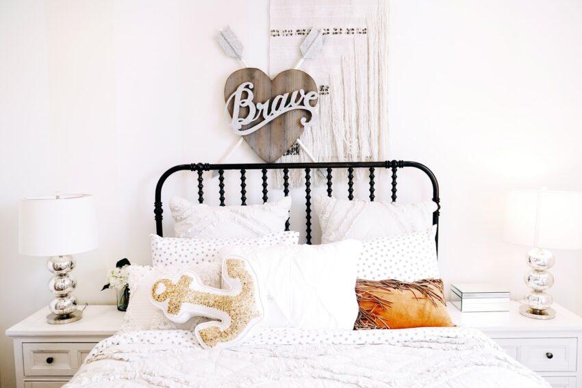 pillows on bed beside headboard